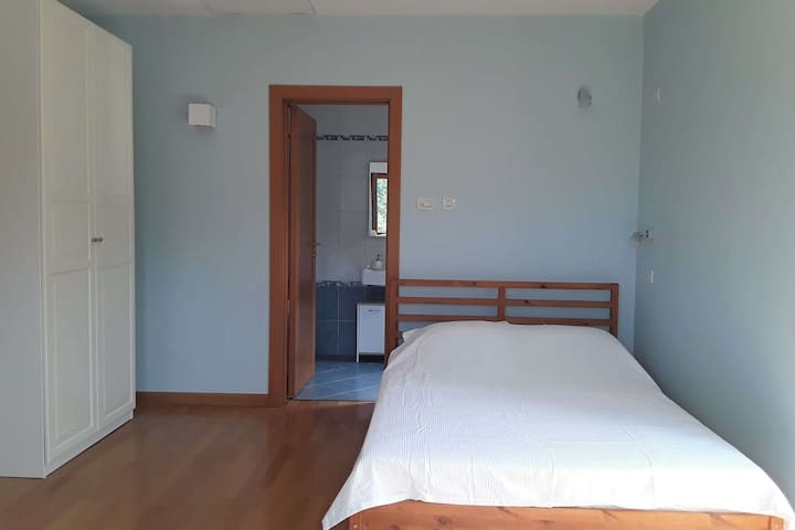 Bedroom 2: Double bed, Wardrobe, chest of drawers, table, stool,  TV