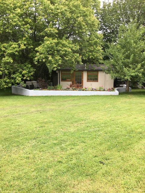 Delightful 2 bed chalet with patio in large garden