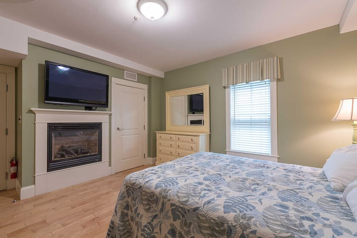 Queen sized bed; large closet; dresser, fireplace; TV; AC.