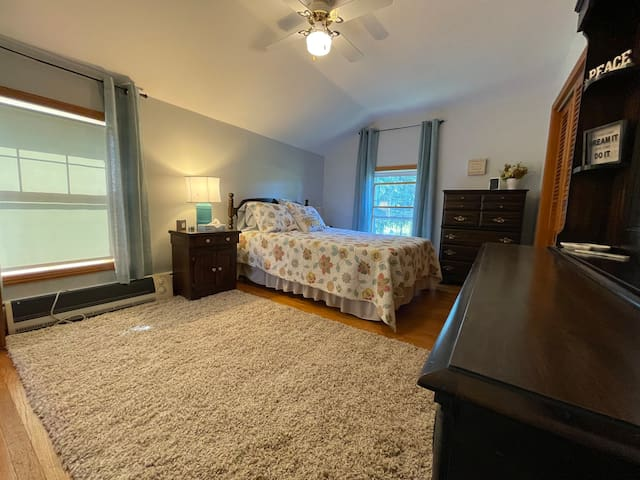 Farm fresh room. Large upstairs bedroom #1 with a full size bed.  This room has a dedicated work area which could also be used as a dining table.  USB outlets are provided on either side of the bed for your convenience.