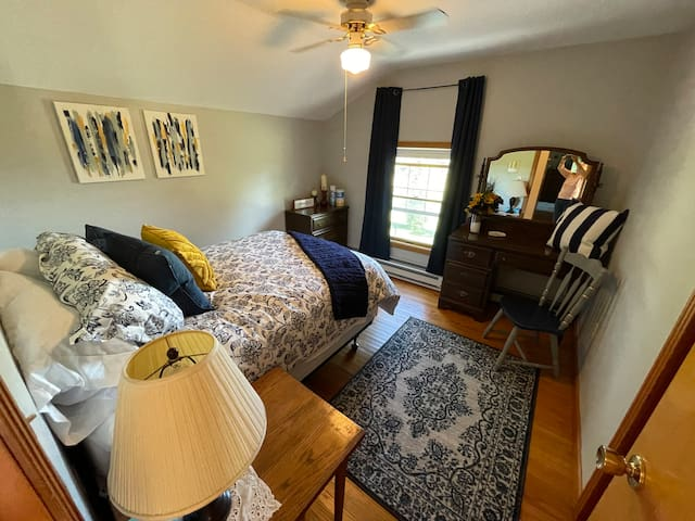 Sunflower room Upstairs bedroom #3.  You will adore the full size bed with a view of the valley. USB outlets are provided on either side of the bed for your convenience.