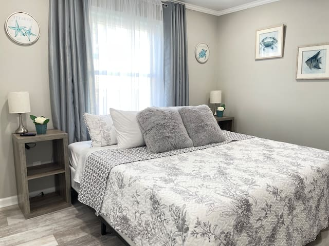 Doze off in style and comfort in this coastal, farmhouse-inspired bedroom with an ensuite bathroom. Choose from premium down-alternative or gel cooling pillows as you enjoy a peaceful night's sleep on new comfort gel mattresses.