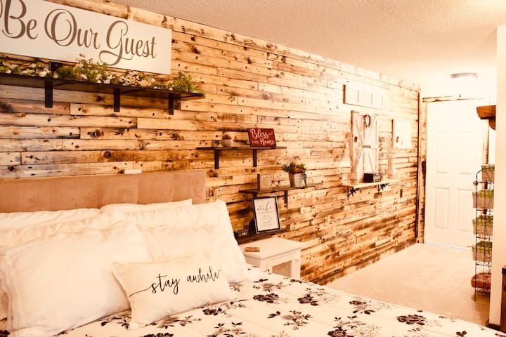 We love the look of natural wood so we have enjoyed adding this pallet wall. We have a comfortable Queen size bed and we've used Organic Bamboo Sheets for extra softness and comfort. We hope you enjoy your stay here and we hope you return!