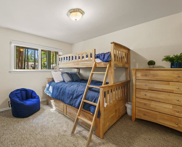 Full size bed with bunk above and trundle bed below. Has its own TV and closet.