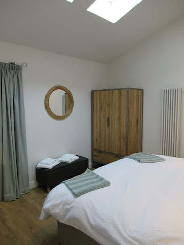 Super kingsize bed can be split into two singles.    We're in a dark skies area so lie back and look out through the skylight windows (but there are black out blinds for when you want a lie in!)