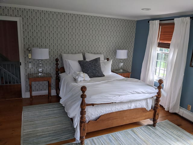 Gloucester Cottage is a three room suite featuring a queen bed and delightful nook with  an additional full sized bed.
