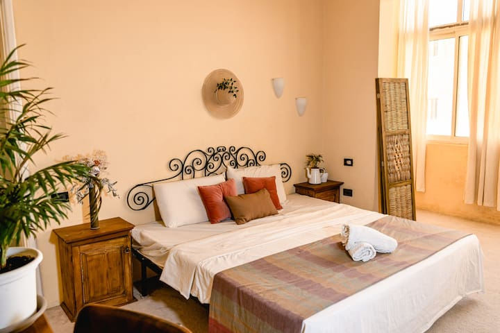 The bohemian bedroom with a comfortable & large king size mattress, suitable for two.