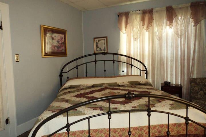 King Size Bed First Bedroom, Fireplace, TV, Dresser