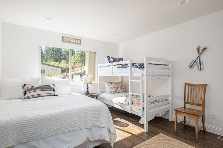 Main Floor Bedroom, Queen Bed and Bunk with 2 Twin Beds.