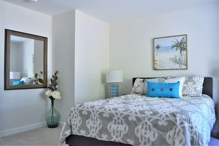 Main level secondary bedroom.