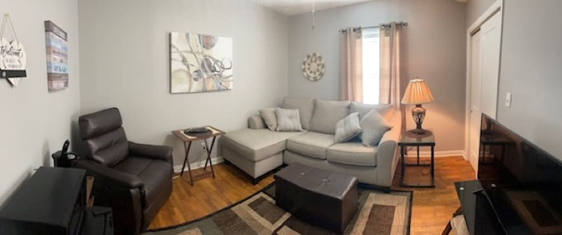Den/bedroom (pictured with sofa -sleeper folded in).  Room includes a TV, mini refrigerator, a microwave, and a coffee center with complementary coffee/tea.  Brand new comfortable queen sofa bed, dresser drawers (in closet) & comfortable recliner.