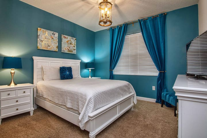 1st floor bedroom with queen bed and bathroom adjacent to bedroom and cable TV.