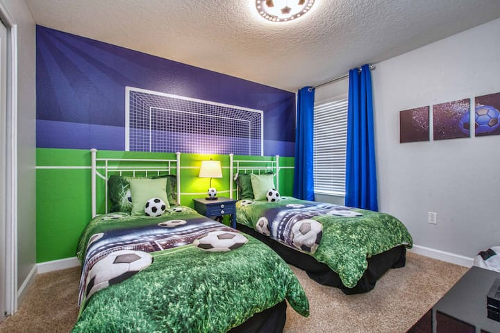 Soccer themed bedroom with  2 twin (single) beds