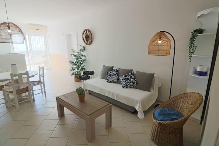 Bright and cosy living room with large windows to the private balcony area.