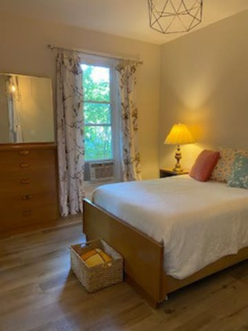 spacious bedroom with window a/c