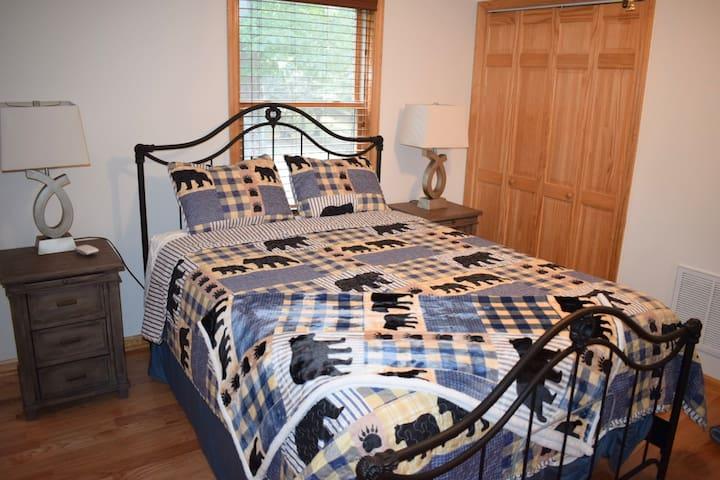 """LOFT BED ROOM Queen Tempurpedic bed w/remote, dresser, closet with hangers, nightstands, and 55"""" Smart TV."""