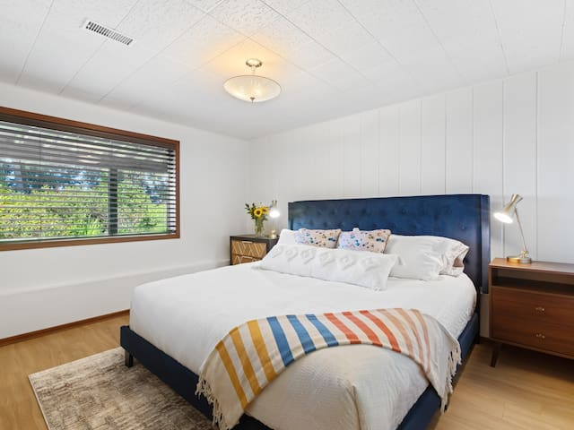 The lower bedroom has an ensuite bathroom with shower, and a new (July 2021) Stearns and Foster King mattress