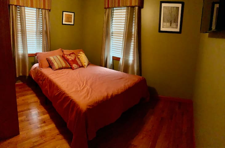 """Bedroom 2 has a full size bed and a 32"""" Roku TV. You'll also find a ceiling fan and a large closet in this bedroom along with extra sheets and some air mattresses for additional guests."""
