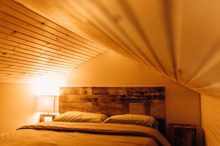 Queen bed upstairs.