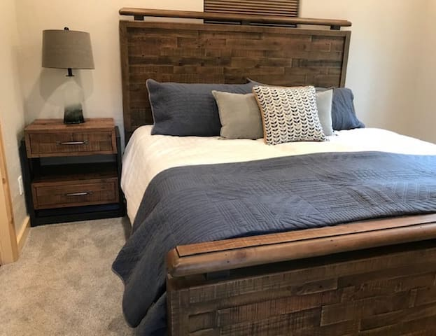 The first floor bedroom has a king bed, dresser, nightstand and closet; (and direct access to the bathroom).