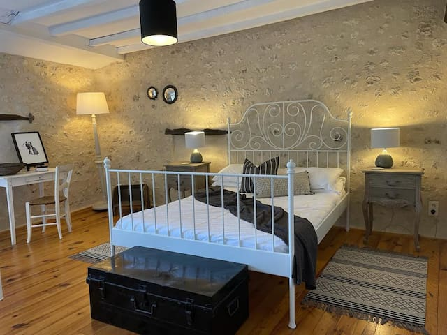 This large and spacious bedroom called Ceanothe is in La Ferme and has a double and a single bed, offering flexible sleeping arrangements for families, also with space for one of our cots. It has a huge wardrobe area and a small Juliet balcony.