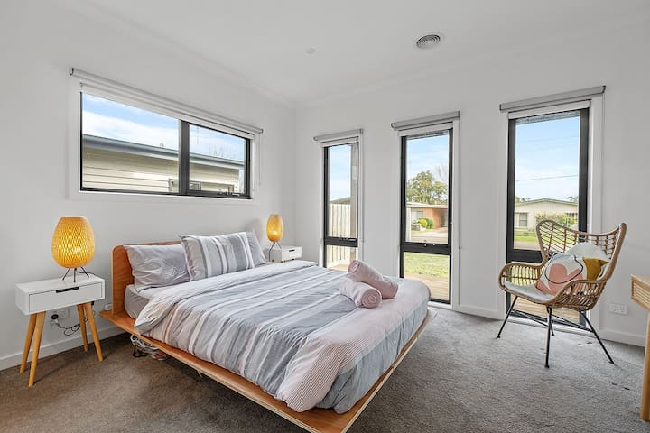 The light-filled master is located on the ground floor and takes in views over the front garden.