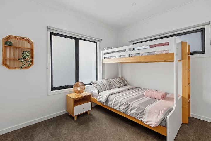 In the third bedroom, the bunk bed has a single on top and double below, comfortably sleeping three guests.