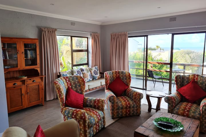 Open plan lounge area leading to a patio with a lovely sea view. Family games and books are readily available for relaxation. Spectacular views from every window !