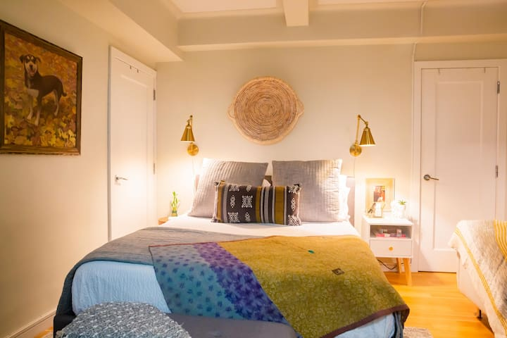 queen bed with reading lights and side tables.