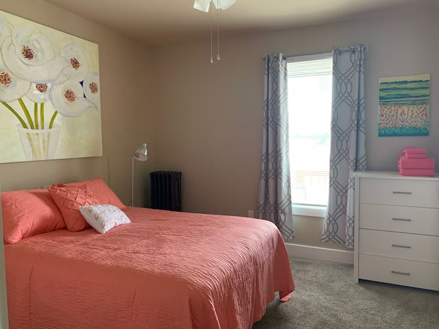 Comfy and fresh master bedroom with traditional Queen mattress and box springs.
