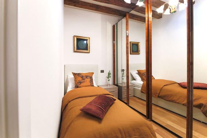 single bedroom with a big wardrobe
