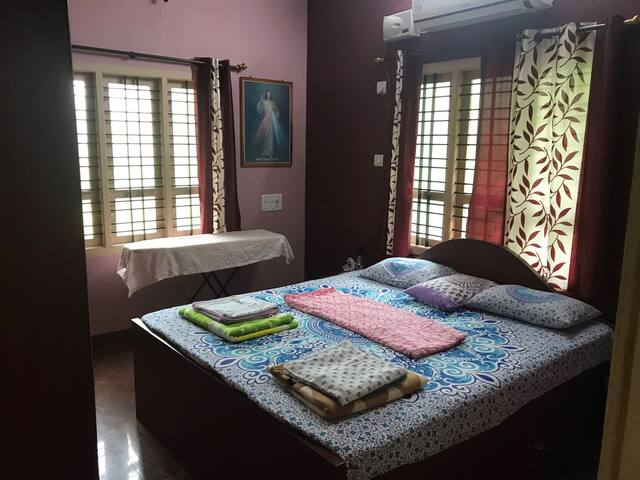 Master Bedroom- King size Bed, AC, Fan, Iron table, Light, 1 cupboard and 2 Drawers