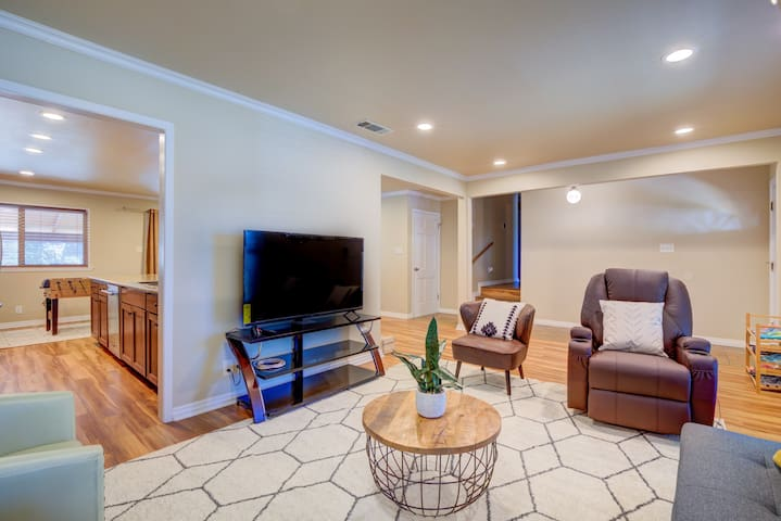 Spacious and cozy living room filled with natural light. Relax and unwind on the comfortable massage chair!