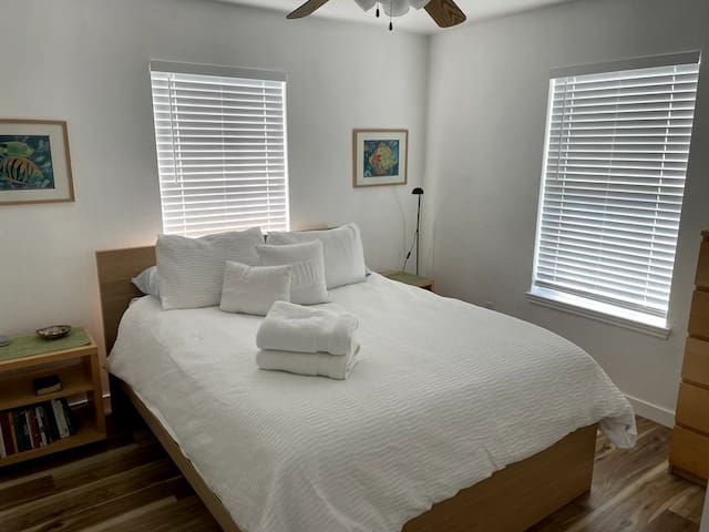 Master bedroom A with queen bed and wardrobe and closet/tv