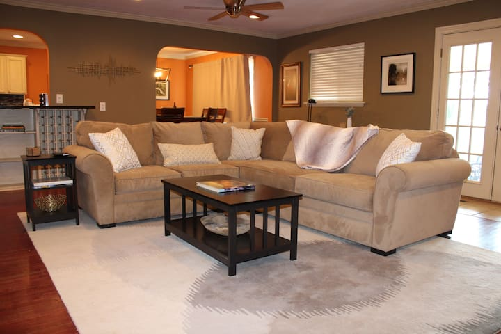Comfortable sectional for watching TV or relaxing! Sofa features full-size foldout bed. Bedding can be found in the hallway linen closet.