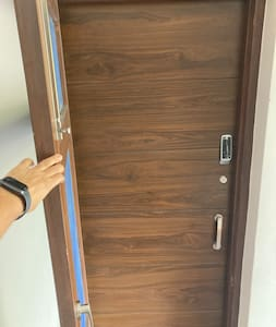 There are two doors. First one is mesh door for ventilation which doesn't have any outside lock. Second one is the main door with two locks.