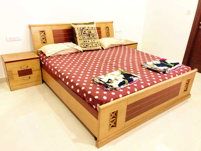 Full King Size Bed In a Spacious Room