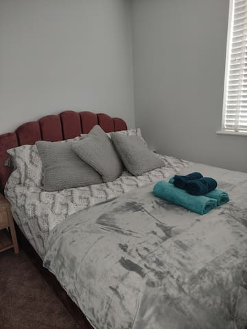 Luxury king size bed and bedding.