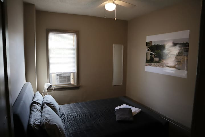 Bedroom #3 features a cozy Queen size bed, window air conditioning unit, closet, mirror, and nightstands.