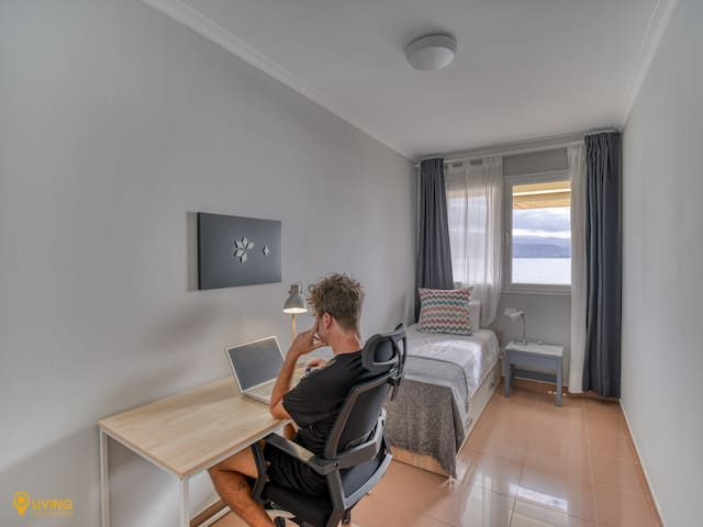 In case you intend to work remotely, the apartment includes a desk, an office chair, a computer monitor and a reading lamp.