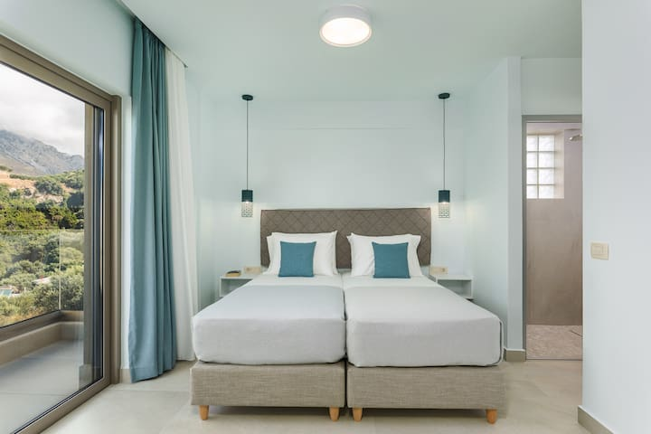 The second twin bedroom is bright and airy.