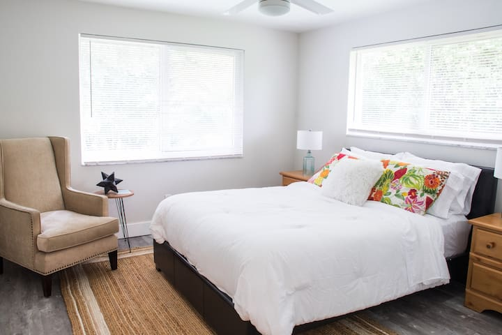 Guest bedroom #1 with queen sized bed, water views, a large smart TV, and plenty of closet space!