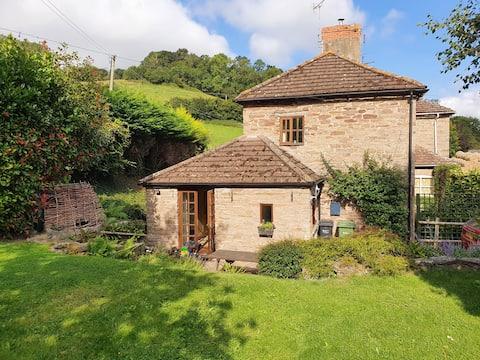 Picturesque cottage on edge of riverside village
