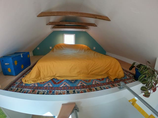 The bedroom upstairs.  140x 200cm. It is high enough to sit on the bed, but not high enough to stand..