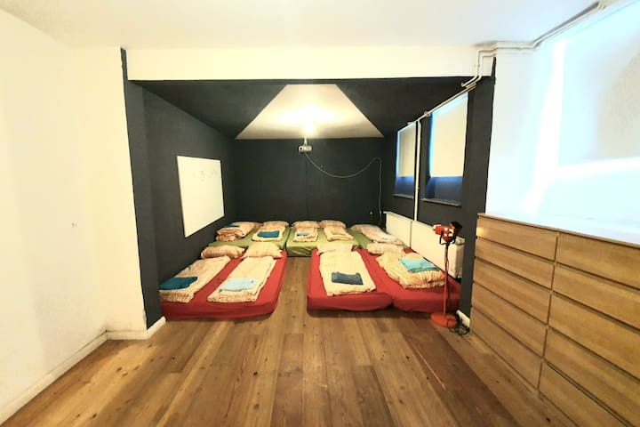 Huge 32m2 bedroom where a family or a cozy group of friends can all sleep together and watch movies.  Picture shows setup for a group of 9 people.