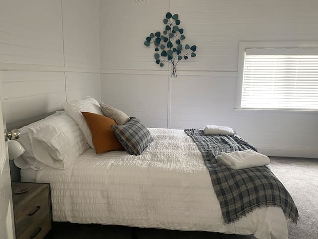 Third bedroom with queen bed and ample space.