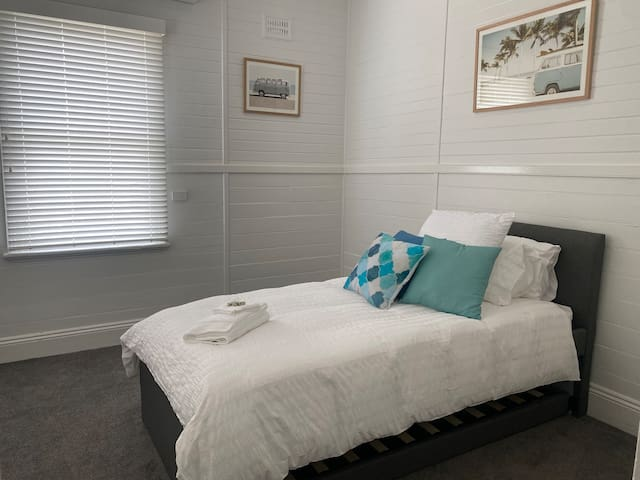 Bedroom with pullout single bed.