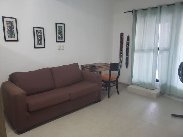 The sofa converts into another full size bed should you require it, and the table can be used as a work station or for dining. Your private entrance is behind the curtains.