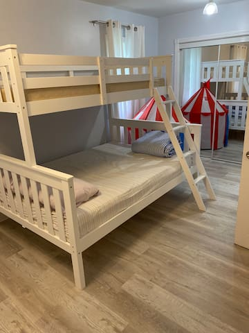 Bedroom 2 - Kids bunk includes a full size bed at the bottom and a twin size at the top. A fold-out crib and fold-out bed are stored in the closet for additional family guests.