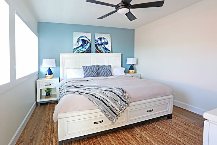"""[Master Bedroom] Sleep soundly on our new premium king mattress and fine linens. The bedroom also has a 50"""" TV with plenty of streaming channels for movie night or binge watching :)"""